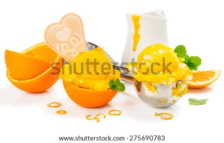 Ice cream with fresh orange fruit in a spoon, rind and sauce, mint isolated on white background - stock photo