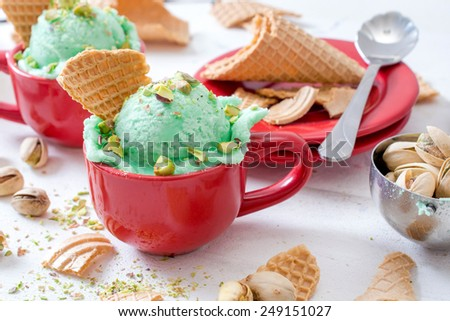 Ice cream with pistachio flavor in the cup,selective focus - stock photo