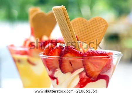Ice cream with strawberries and waffles/ice cream/sundae - stock photo