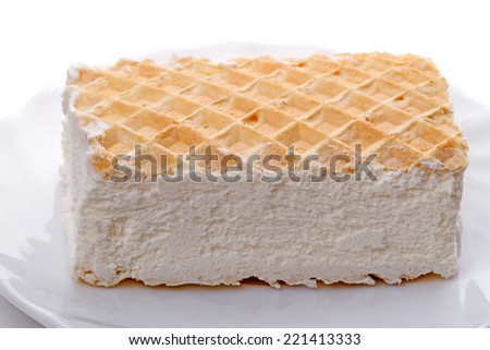 Ice cream with wafers on a white plate  - stock photo