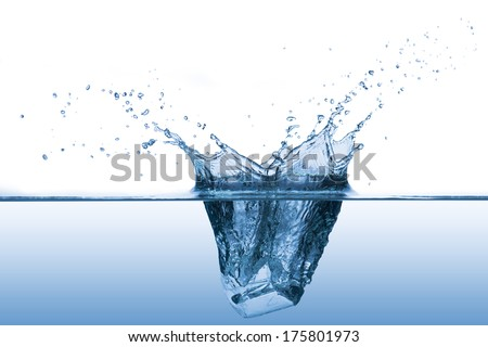 Ice Cube Drop into water to make water splash - stock photo