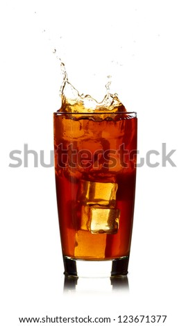 Ice cube droped in cola glass isolated on white background - stock photo