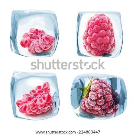 Ice cube frozen raspberry isolated on white background. - stock photo