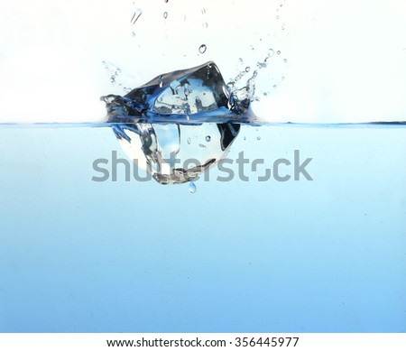 ice cube in water - stock photo