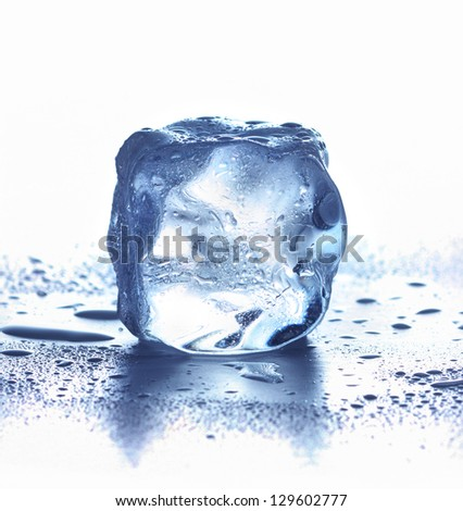 Ice cube isolated on white. - stock photo