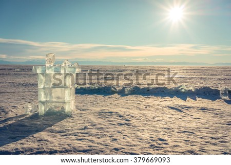 ice cube sculpture tower shape on frozen baikal lake - stock photo