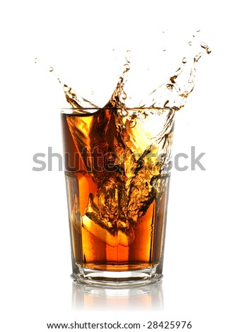 ice cube splashing into glass of coke - stock photo