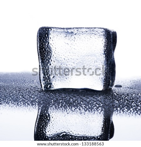 Ice Cube with water droplets - stock photo