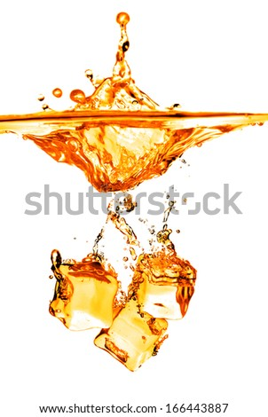 ice cubes dropped into orange water with splash isolated on white - stock photo
