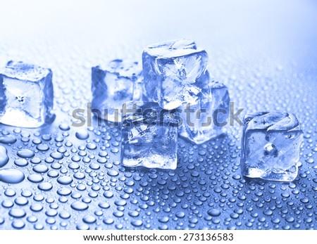 ice cubes on blue background - stock photo