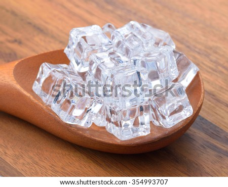 Ice cubes on chopping board. - stock photo
