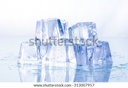 Ice cubes with condensation isolated on white background. - stock photo