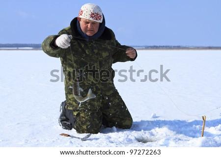 ice fishing - stock photo