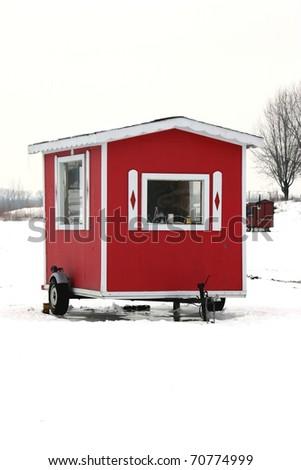 ice fishing cabin - stock photo