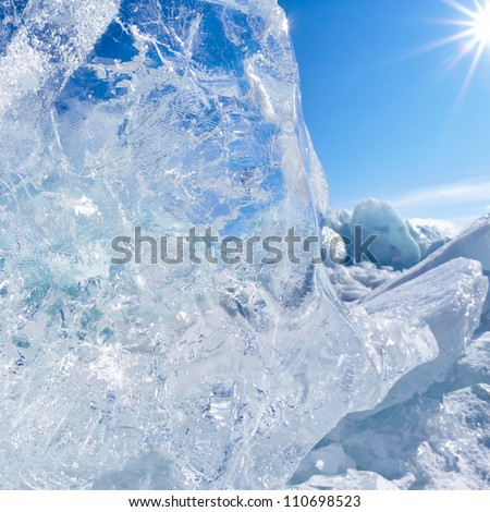 Ice floe and sun on winter Baikal lake - stock photo