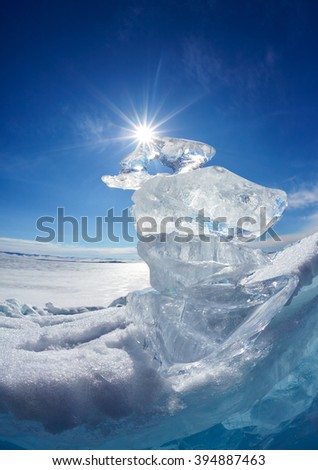 Ice floe crystals and sun over winter Baikal lake - stock photo