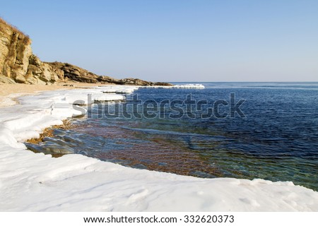 Ice Floe, Icy shore of the sea,  North sea, cold sea of the North, winter ice, white snow of the Arctic, Arctic ocean, beautiful winter nature. Beach at the winter ocean. Spring Arctic. Melting of ice - stock photo