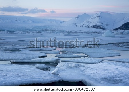 Ice floes washed up on blank sand beach at Jokulsarlon glacial lagoon, Iceland  - stock photo