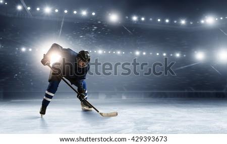Ice hockey player at rink - stock photo