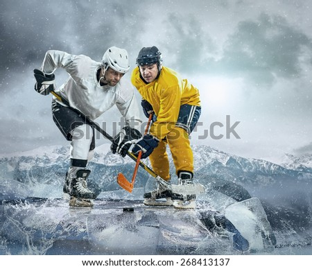 Ice hockey player on the ice - stock photo