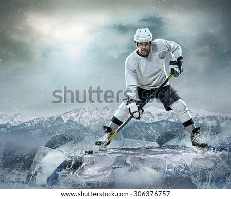 Ice hockey player on the ice - stock photo