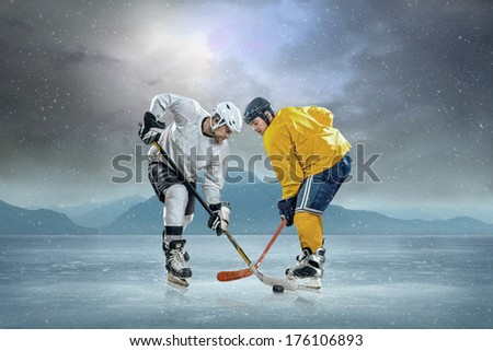 Ice hockey players at the ice. - stock photo