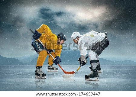 Ice hockey players on the ice - stock photo
