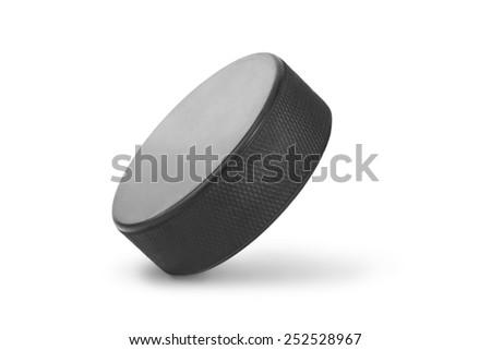 Ice hockey puck isolated on white background - stock photo