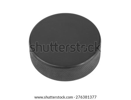 Ice hockey puck isolated on white background - stock photo