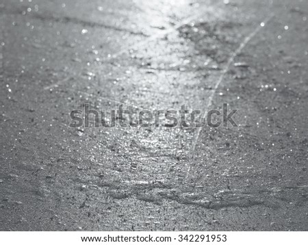Ice hockey rink surface closeup, skate traces, winter sport background, selective focus, shallow depth of field - stock photo