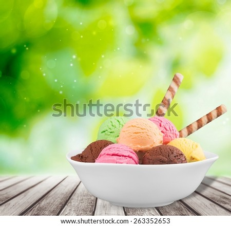 Ice. Ice cream scoops in bowl with wafer on white background - stock photo
