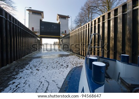 Ice in a sluice in a Dutch canal - stock photo