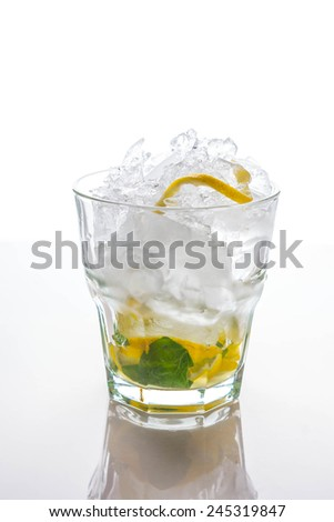 Ice, lemon and mint in the glass - stock photo