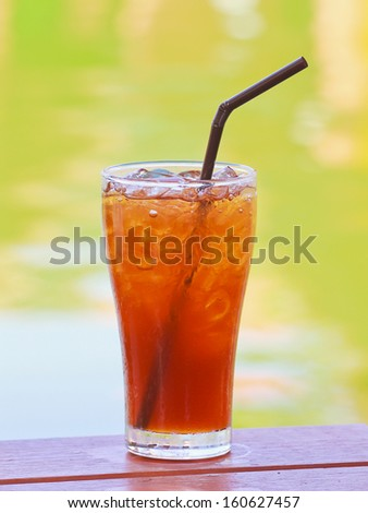 Ice lemon tea on wood table - stock photo