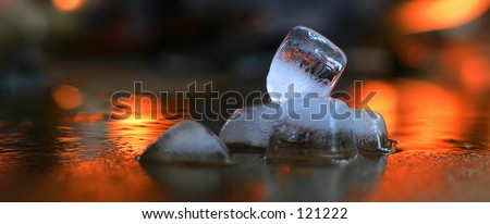 Ice melting  with flames on background. - stock photo