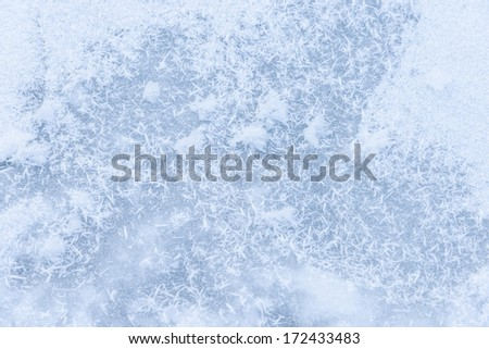 ice on the frozen pond with snowflakes abstract shapes background - stock photo