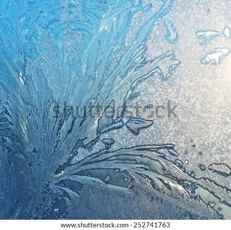 ice pattern and morning sunlight - stock photo