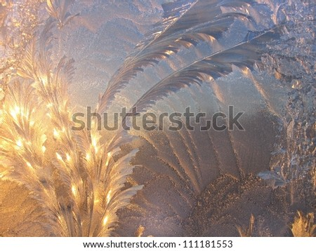 Ice pattern and sunlight on winter glass - stock photo