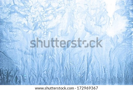 Ice pattern on window in winter time - stock photo