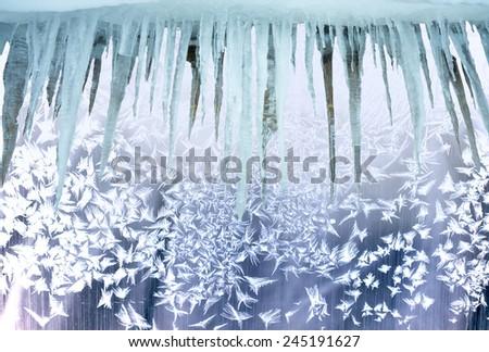Ice patterns on winter glass. - stock photo