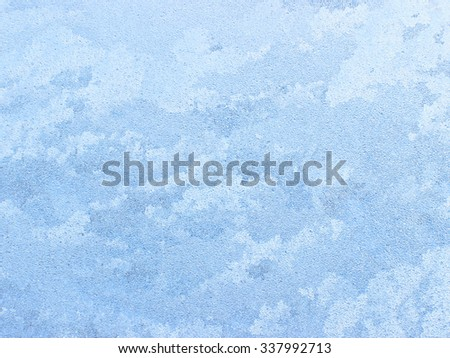 Ice patterns on winter glass - can be used as a background.