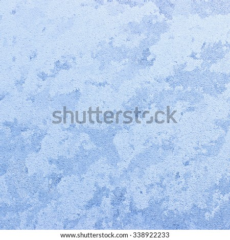 Ice patterns on winter glass - can be used as a background. - stock photo