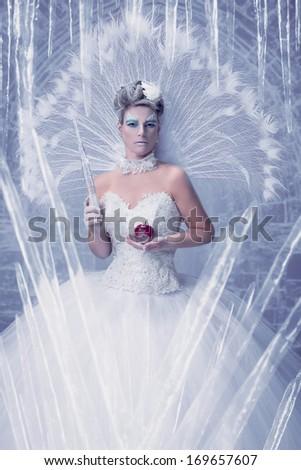 Ice queen in her frozen castle - stock photo