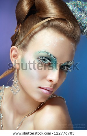 ice-queen. Young woman in creative image with silver artistic make-up. - stock photo
