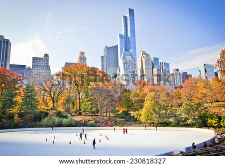 Ice skaters having fun in New York Central Park in fall  - stock photo