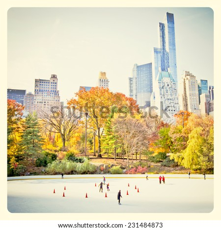 Ice skaters having fun in New York Central Park in fall with Instagram style filter - stock photo
