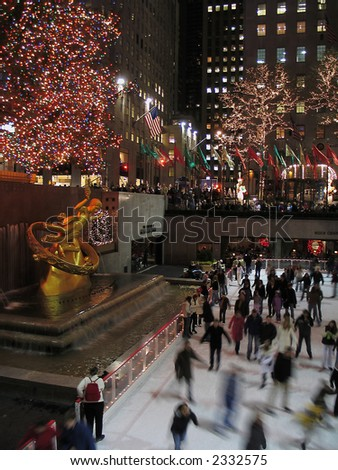 Ice Skating and Christmas tree in Rockefeller Center, New York City - stock photo