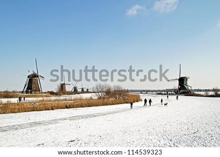 Ice skating at Kinderdijk in the Netherland - stock photo