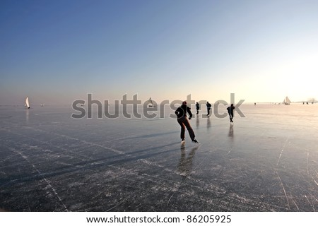 Ice skating on the Gouwzee in the Netherlands - stock photo