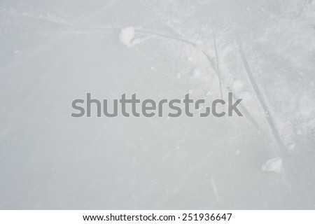 Ice texture on outdoor rink with snow - stock photo